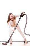 Rolig flicka med dammsugare hushållsarbete Royaltyfri Bild