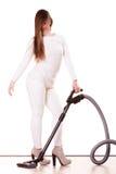 Rolig flicka med dammsugare hushållsarbete Royaltyfri Fotografi