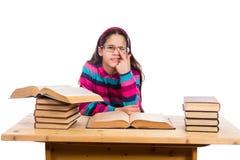 Rolig flicka med högen av böcker Arkivfoton