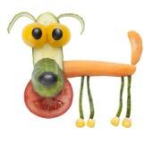 Rolig hund som göras av grönsaker Arkivbilder