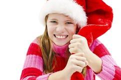 Rolig ilsken flicka med jultomtenhatten royaltyfri fotografi