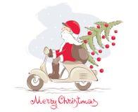 Rolig jultomten på en sparkcykel Arkivfoton