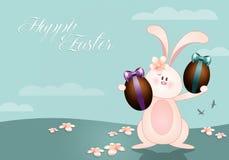 Rolig kanin med chokladägg Arkivbild