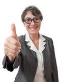 Rolig lady med tumen upp Arkivbild