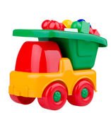 Rolig leksakbil med byggnadskvarter Fotografering för Bildbyråer