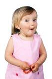 Rolig liten flickadanande vänder mot arkivfoton