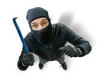 Rolig maskerad rånare eller tjuv Sikt från överkant eller från gömd kamera Arkivbild
