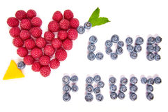 Rolig mat Hjärta och bokstäver som göras från frukter Royaltyfri Foto
