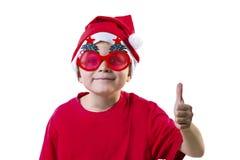 Rolig pojke Santa Claus i en hatt och exponeringsglas Arkivbild