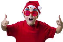 Rolig pojke Santa Claus i en hatt och exponeringsglas Royaltyfri Fotografi