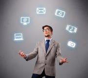 Rolig pojke som jonglerar med symboler för elektroniska apparater Fotografering för Bildbyråer