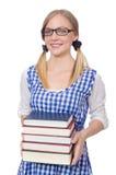 Rolig student med bunten av böcker Fotografering för Bildbyråer
