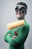 Rolig superhero med målningrullen Royaltyfria Bilder