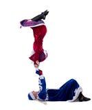 Roliga akrobater utför i dräkter för nytt år Arkivfoton