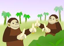 Roliga apor med bananer Arkivfoton