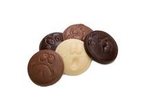 Roliga emoticons som göras av smaklig olik choklad Arkivbild