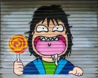 Roliga färgrika grafitti Arkivbilder