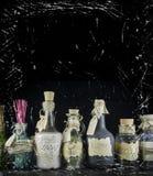 Roliga flaskor på svart bakgrund Arkivfoto