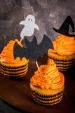 Roliga muffin för allhelgonaafton Royaltyfri Foto
