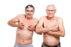 Roliga pensionärer som visar huvuddelen Royaltyfri Foto