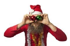 Roliga Santa Claus med julbollar Royaltyfria Foton