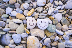 Roliga smileys av kiselstenar Arkivfoton