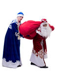 Roliga utbytta dräkter för jultomten och för snö jungfru Fotografering för Bildbyråer