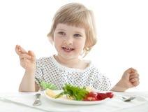 Roligt äta för liten flicka arkivbild