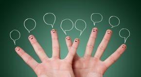 Roligt fingra smileys med bubblar Royaltyfri Foto