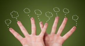 Roligt fingra smileys med bubblar Arkivbild