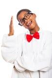 Roligt klyftigt göra en gest för pojke Fotografering för Bildbyråer