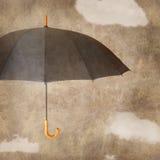 Roligt paraply på brun grungy bakgrund Arkivfoto