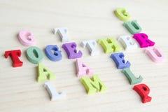 Roligt tecken för bokstavskorsordpussel Fotografering för Bildbyråer