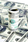 Rolka dolarów stos jako tło Obrazy Royalty Free
