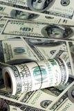 Rolka dolarów stos jako tło Obrazy Stock