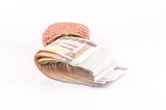 Rolka tajlandzki banknot w portflu odizolowywającym na białym tle obraz stock