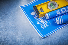 Rolki błękitni budowa rysunki równi na kruszcowym tle Fotografia Stock