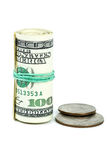 Roll of $100 banknotes and coins near Stock Photography
