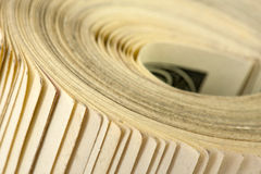 Roll of $100 bills. Close-up view of roll of $100 bills Royalty Free Stock Photos