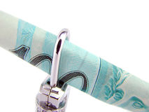 Roll of 100 real brazilian money in closed padlock Stock Photos