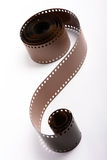 Roll of 35mm film. Over white background Royalty Free Stock Photography