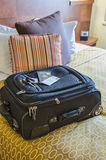 Roll Aboard Bag on a Hotel Bed Stock Images