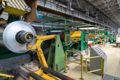 Roll of aluminum rotates on machine. In workshop on rolling mill Royalty Free Stock Photos