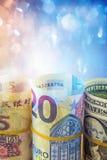 Roll of american dollar bill, five yuan and twenty euro Stock Image