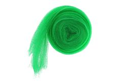 A roll of  anti bird Garden netting in green Royalty Free Stock Photo