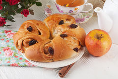 Roll with apple and cinnamon raisin in a still life on  plate  bright Royalty Free Stock Photography