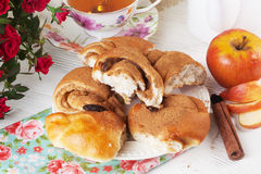 Roll with apple and cinnamon raisin in a still life on plate bright Royalty Free Stock Photo