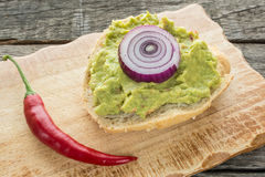 Roll with avocado and red chili pepper Royalty Free Stock Image