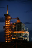 Before roll back. Space shuttle on launch pad at night prior to gantry roll back Stock Photography