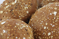 Roll bakery with seeds. Close-up photo of roll bakery at white abackground. Good Appetite Stock Photos